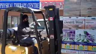 kamaljit singh ghotra driving forklift at all india supermarket, edmonton, ab canada