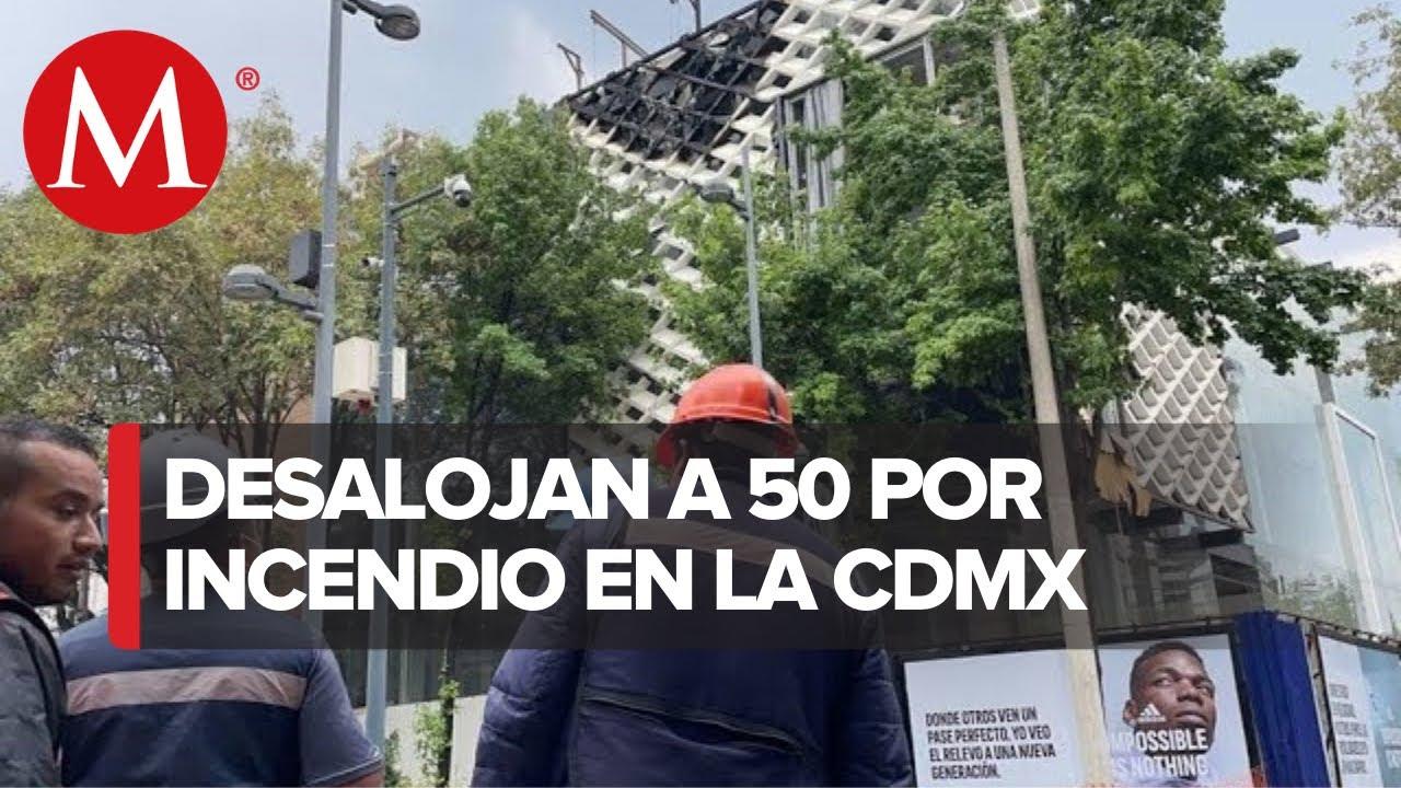 Evacúan a 50 por incendio en edificio