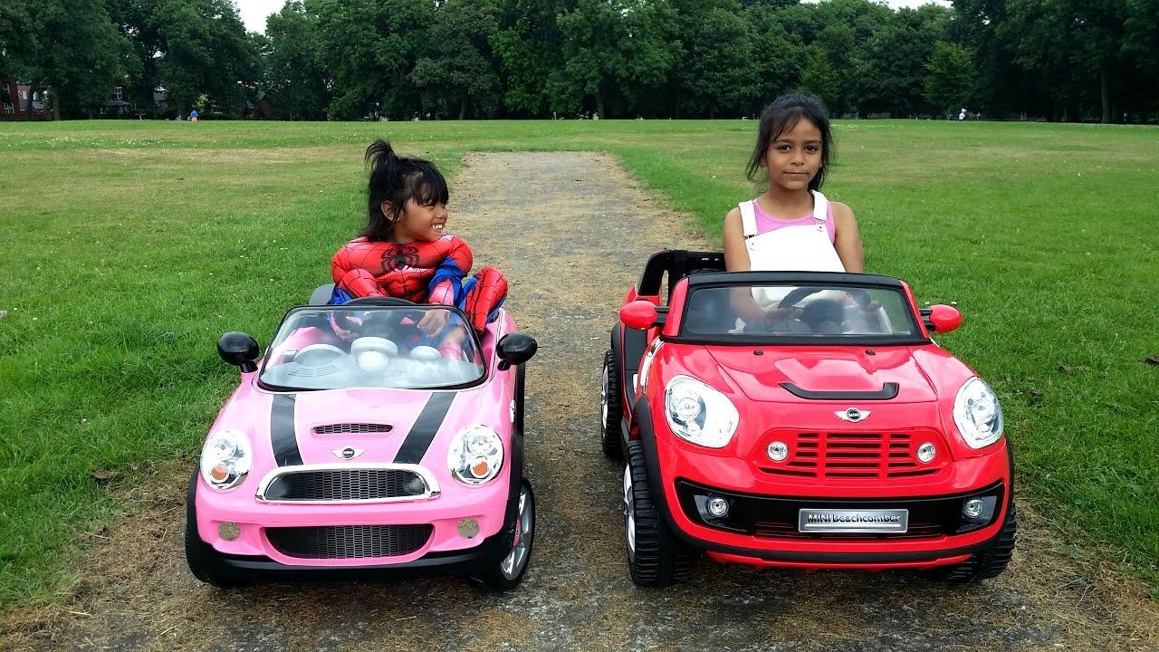 12v Bmw Mini Beachcomber Vs 6v Pink Mini Cooper Race Kids Ride On Toys Youtube