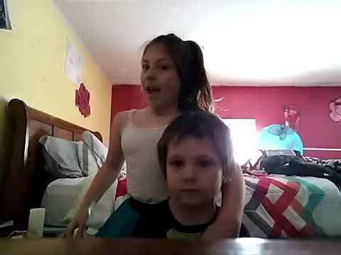 Brother and sister jumping on bed