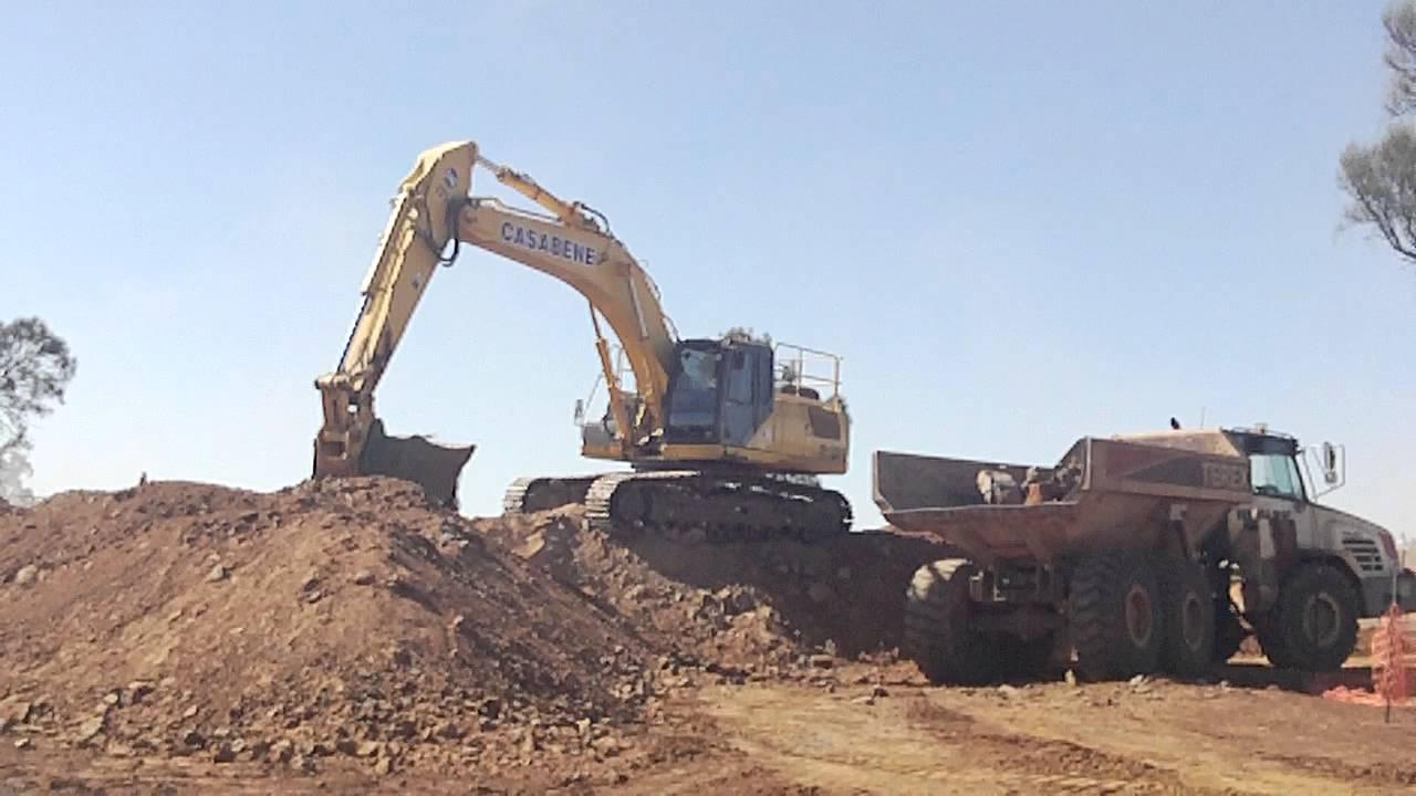 35 ton excavator sorting rock and loading dump truck