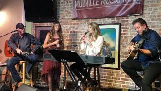 "Katie O singing ""Does He Love You,"" with Linda Davis"