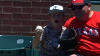 8-year-old fan receives gifts after a catch
