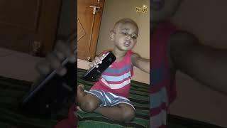 Baby enjoying with headphone