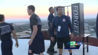 Hundreds of firefighters climb 110 flights of stairs in remembrance of 9/11