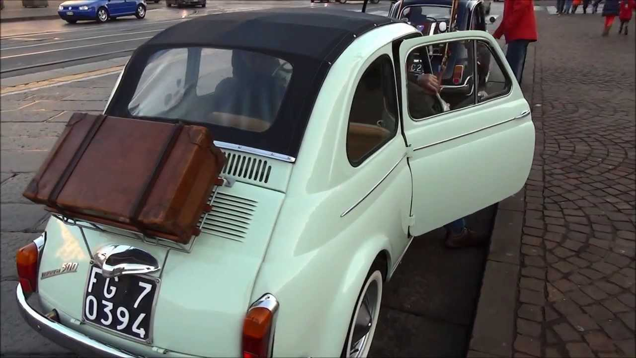 Fiat 500n 1957 First Series Seen Marching On The Road In Turin Italy