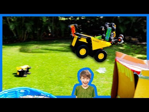 Monster Trucks and Dump Trucks for Kids Ramp Into Orbeez Pool!