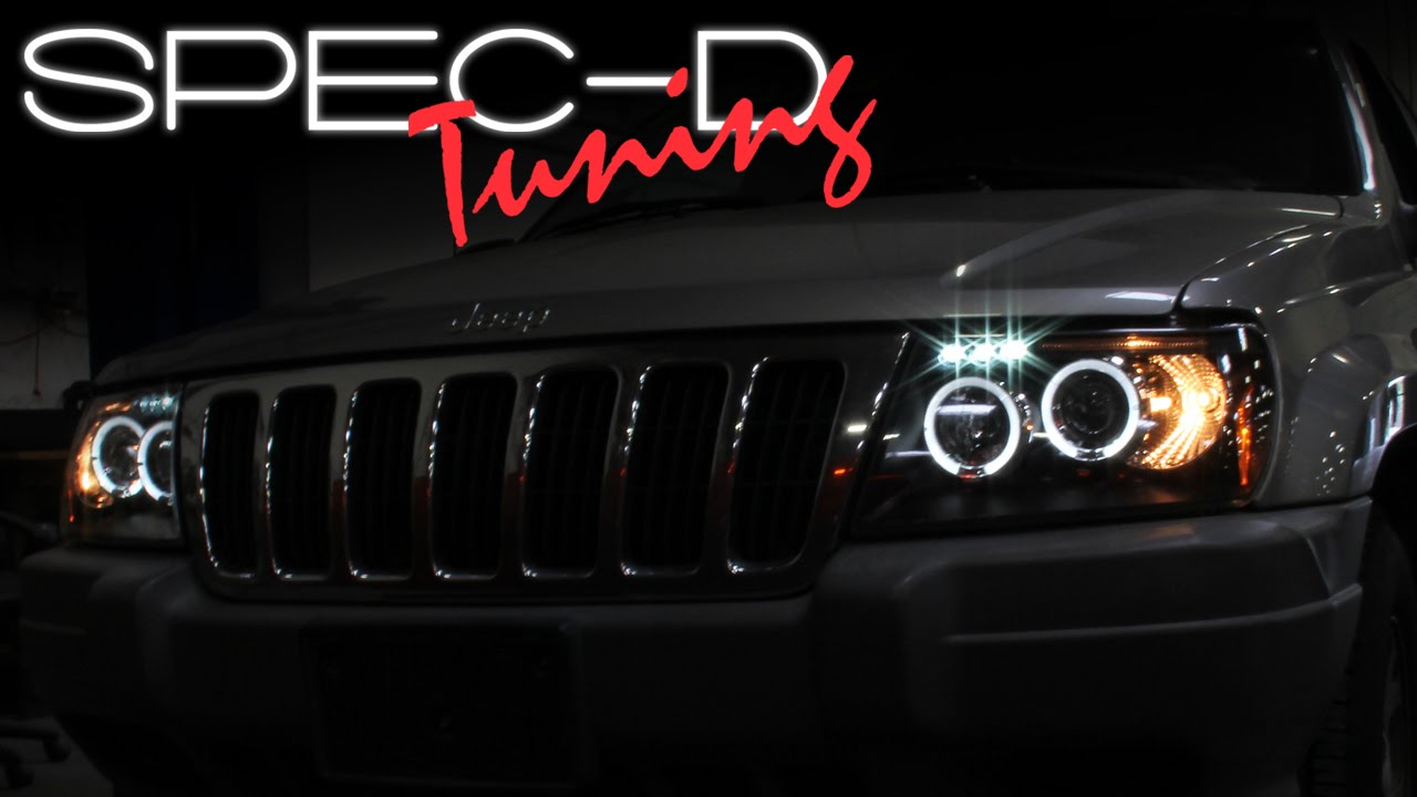 specdtuning installation video 1999 2004 jeep grand cherokee halo led projector headlights youtube [ 1280 x 720 Pixel ]
