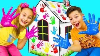 ساشا والآباء يرسمون منازل الكرتون