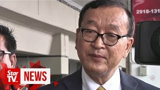 Cambodian opposition figure Sam Rainsy arrives in Jakarta