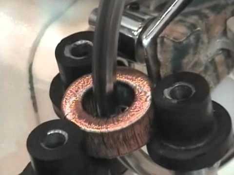 Toroidal winding machine for thin wire