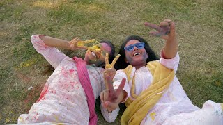 Cheerful Indian girls playing with organic Gulal colors in a park - Holi festival