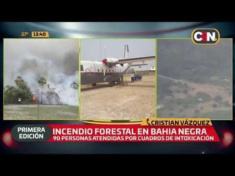 Bomberos luchan contra incendio forestal en bahía negra thumbnail