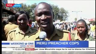 Administration police officers put down their guns for a moment to preach the word of God in Meru