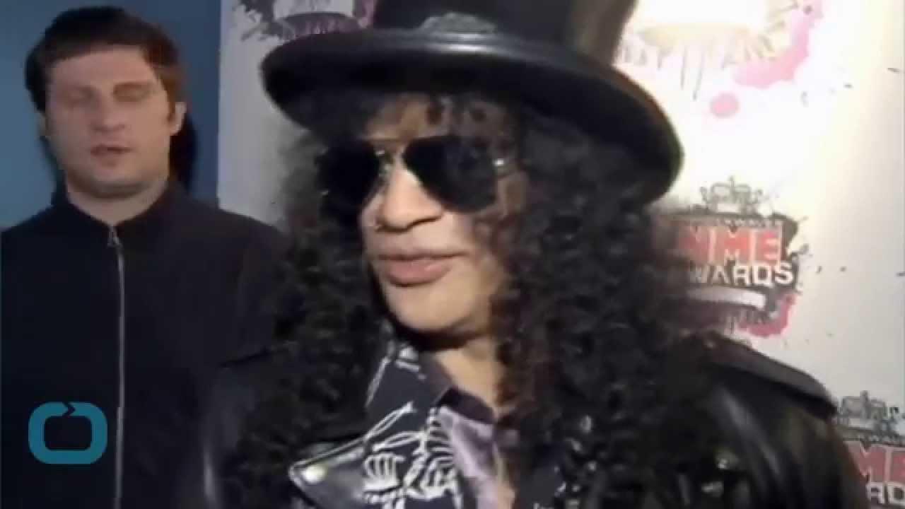 Slash Files for Divorce From Perla Ferrar After 13 Years