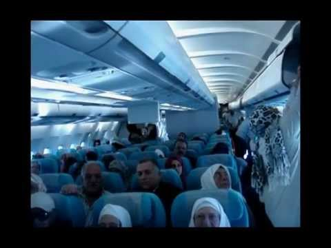 24.03.2013 Umre dönüşü uçakta Yaşar CUHADAR, Mehmet YAMAN ve Kayhan Koçoğlu birlikte