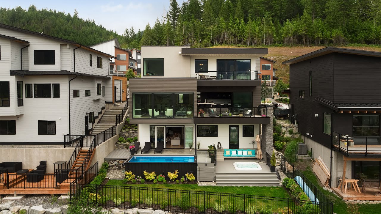 Tour this contemporary mountain view home with a pool