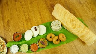 Popular traditional South Indian platter served over a banana leaf on a wooden table