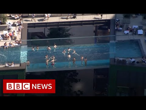 World's first 'floating' pool suspended between London tower blocks - BBC News