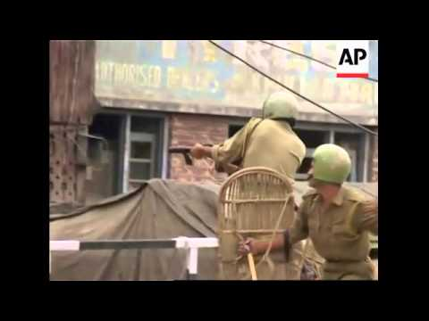 WRAP Thousands protest over transfer of land to Hindu shrine; clashes