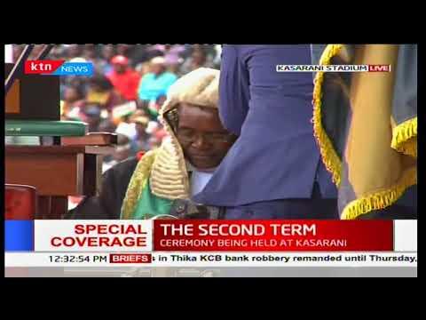 President Uhuru Kenyatta appends his signature during the inauguration ceremony