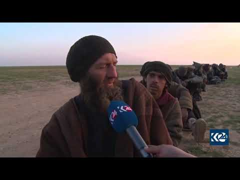 Foreign ISIS fighters talk after surrendering to SDF in Baghouz, Deir al-Zor, Syria