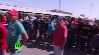 Migrants attempt to cross border bridge from Guatemala into Mexico