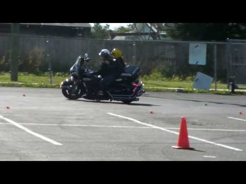 Riding with a passenger and one-handed at the Ride Like a Pro Class