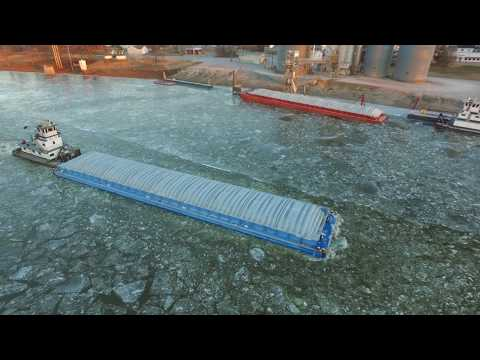 A barge pushing through the icy Kaskaskia River in Evansville, Illinois