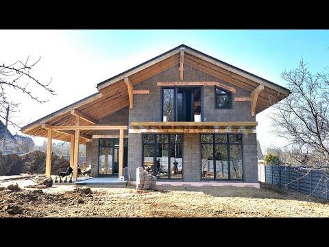 Реализация проекта дома в минском районе. Дом с террасой и балконом