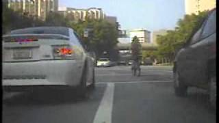 Wrong Way Lane Splitting Bicycle Rider