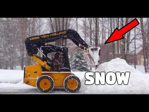 NEW HOLLAND LX565 SKID STEER CARRYING SNOW HD***