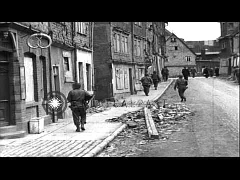 99th Infantry Division enters the city and civilians carrying their belongings wa...HD Stock Footage