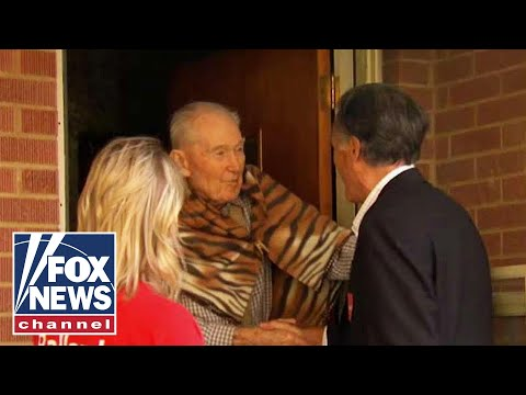 Mitt Romney goes door-to-door as he canvasses Salt Lake City