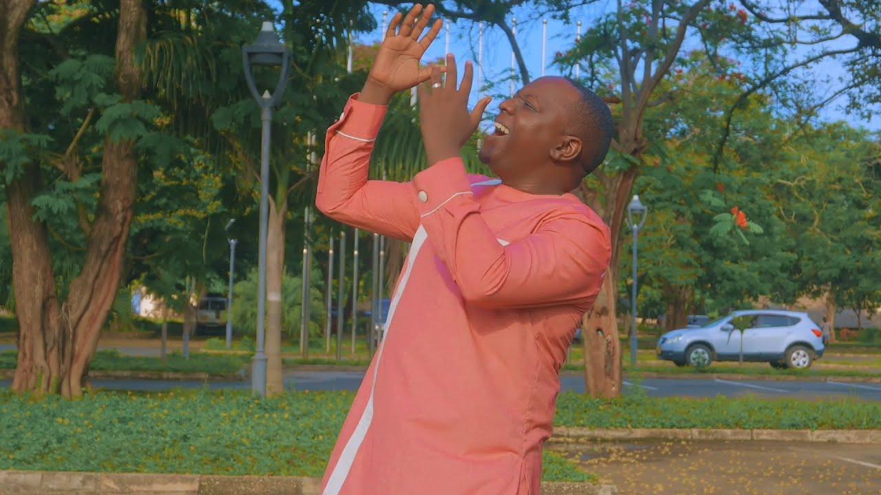 Download CHRISTOPHER MWAHANGILA - MOYO FURAHI   (official Video)simu +255716620000 +255756068844