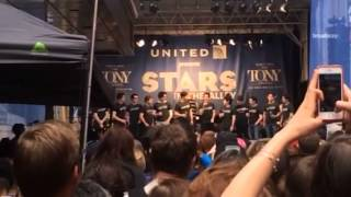 The cast of newsies singing seize the day at Stars In The A