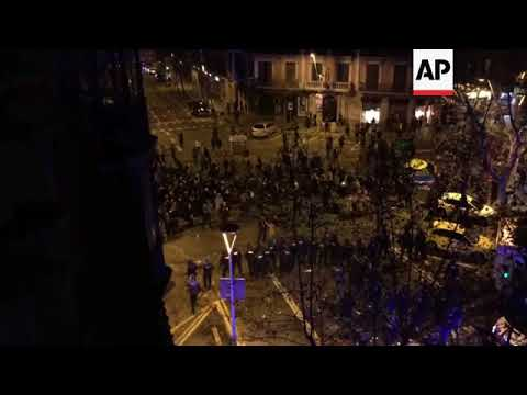 Riot police use vehicles to push back Catalan protesters in Barcelona