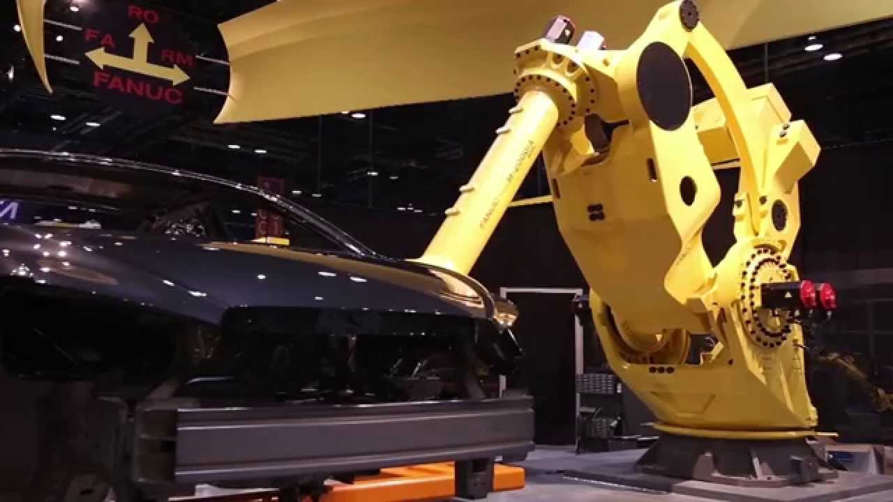 Huge Fanuc Robot Lifts A Whole Car Body For Robotic Engine