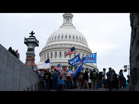 Watch pro-Trump supporters break barricades outside U.S. Capitol Building