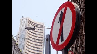 Sensex plunges 463 pts on Fed's hawkish tone; Nifty below 11,000