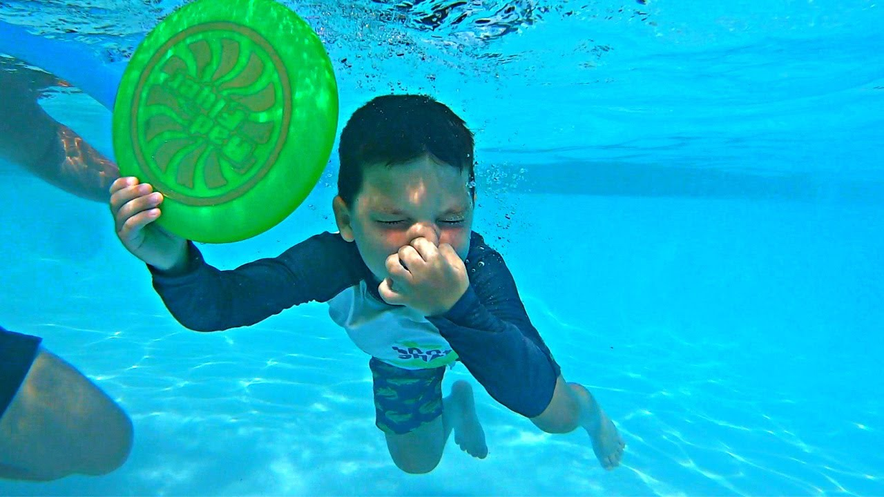 KIDS Swim in GIANT SWIMMING POOL! CALEB LEARNING TO SWIM UNDERWATER with Mom and Dad!