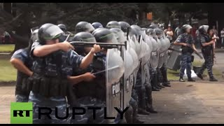 Argentina: Riot police fire rubber-bullets at protesters decrying public sector layoffs