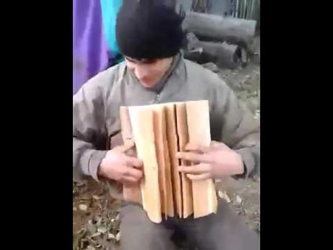 Playing A New Type Of Wooden Accordion :)