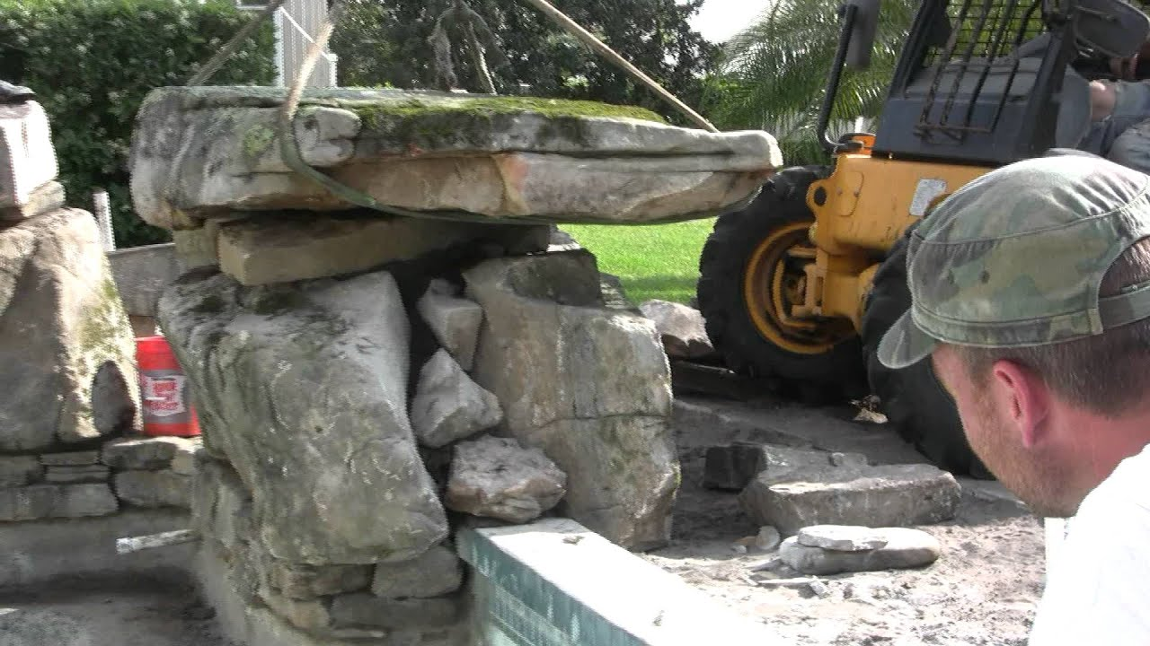 Setting Natural Stone Boulders To Create A Grotto