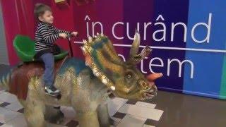 Walking with dinosaurs.  Bogdan`s Show rides a dinosaur in the center MallDova