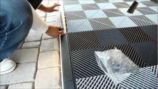 Rubber Flooring Inc Installs Vented XL Garage Tiles
