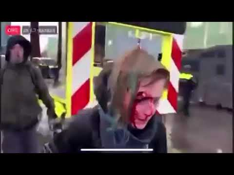 Police unleash canon on peaceful protester in the Netherlands.
