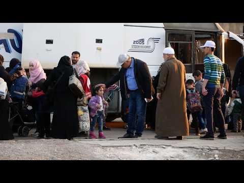 Evacuation of jihadists and their families from Al Waer neighborhood of Homs, Syria