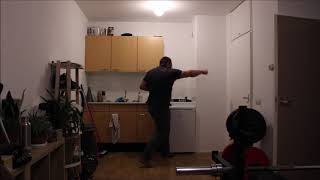 Martial arts One power punch from the side with a normal and a slow motion version