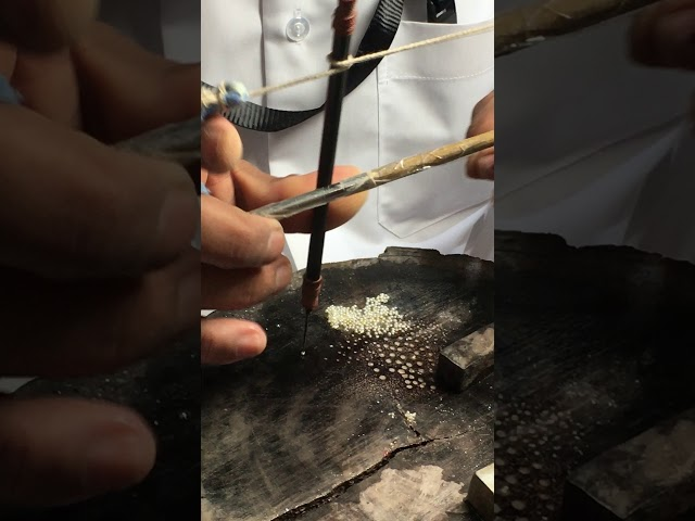 Traditional pearl drilling technique Doha, Qatar